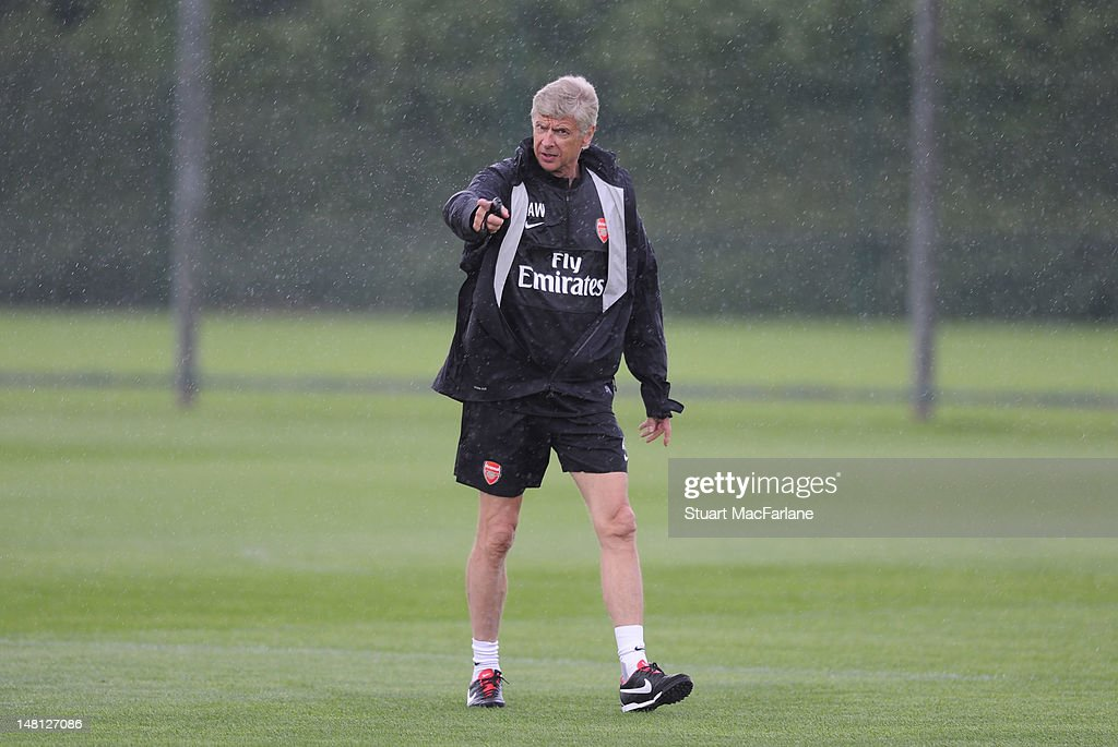 Arsenal manager <a gi-track='captionPersonalityLinkClicked' href=/galleries/search?phrase=Arsene+Wenger&family=editorial&specificpeople=171184 ng-click='$event.stopPropagation()'>Arsene Wenger</a> during a training session at London Colney on July 10, 2012 in St Albans, England.