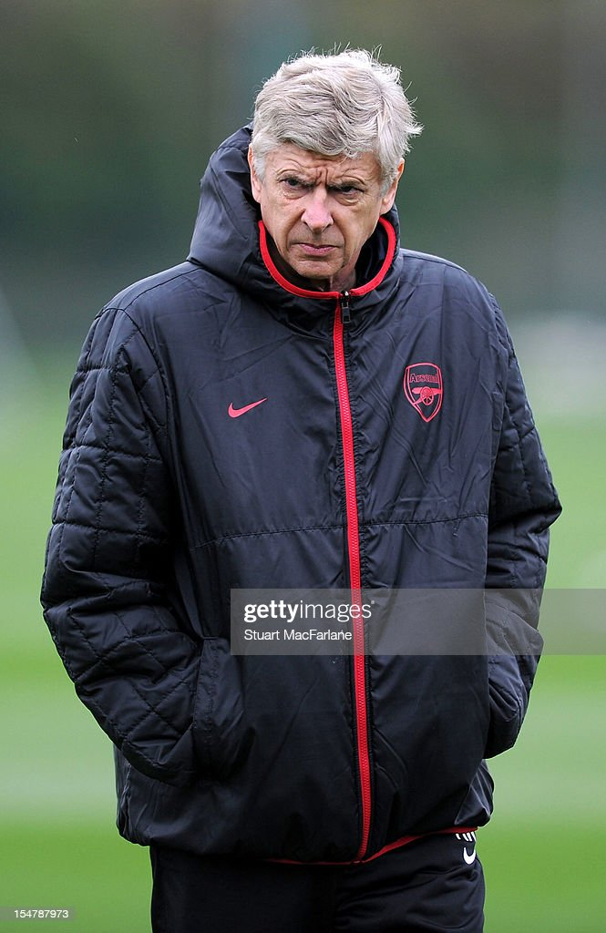 Arsenal manager <a gi-track='captionPersonalityLinkClicked' href=/galleries/search?phrase=Arsene+Wenger&family=editorial&specificpeople=171184 ng-click='$event.stopPropagation()'>Arsene Wenger</a> during a training session at London Colney on October 26, 2012 in St Albans, England.