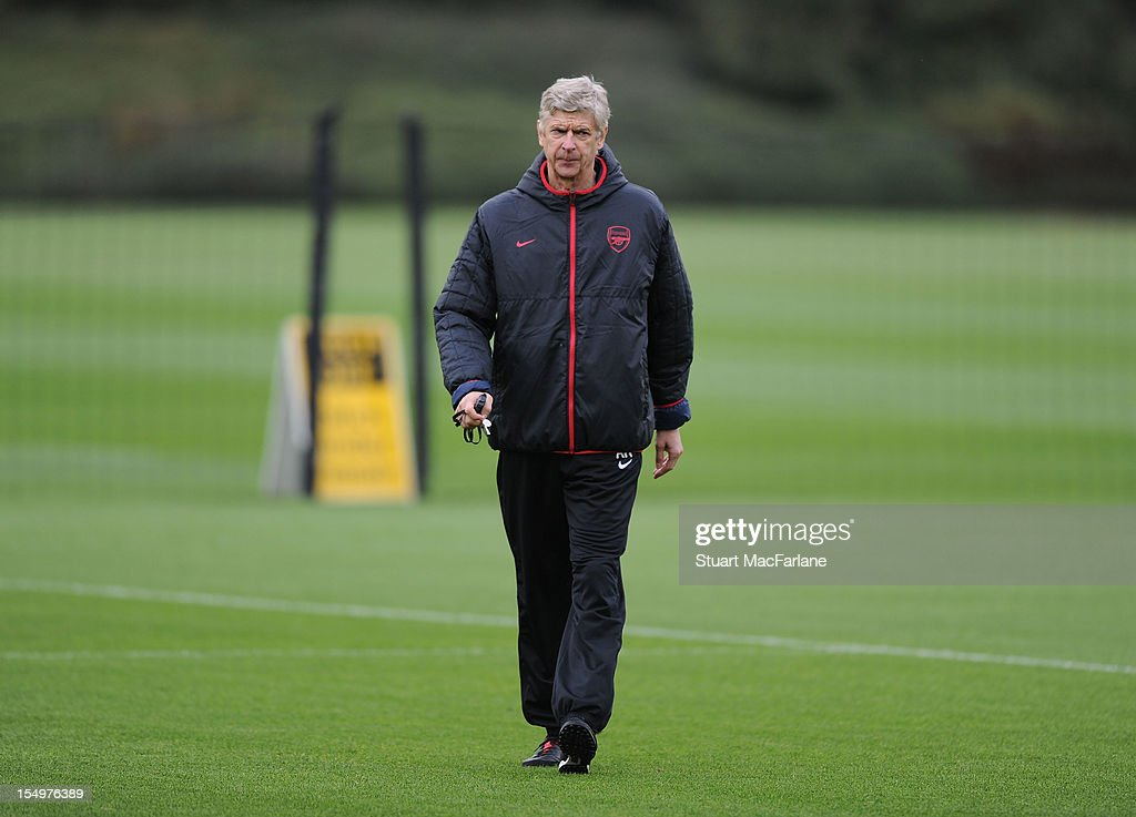 Arsenal manager <a gi-track='captionPersonalityLinkClicked' href=/galleries/search?phrase=Arsene+Wenger&family=editorial&specificpeople=171184 ng-click='$event.stopPropagation()'>Arsene Wenger</a> during a training session at London Colney on October 29, 2012 in St Albans, England.