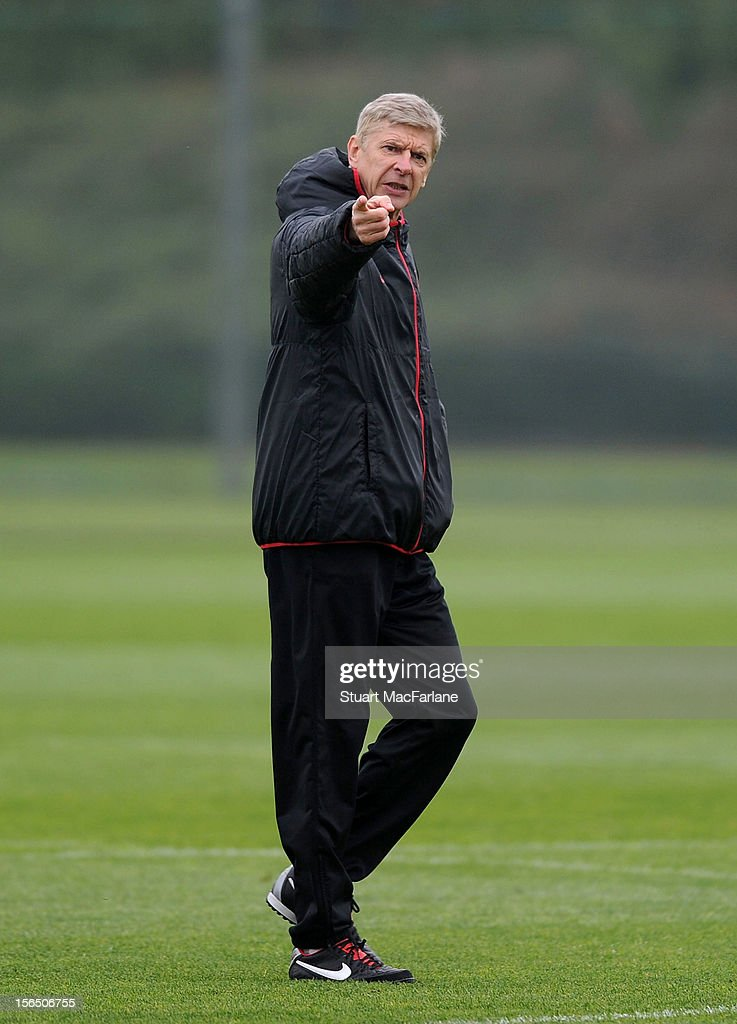 Arsenal manager <a gi-track='captionPersonalityLinkClicked' href=/galleries/search?phrase=Arsene+Wenger&family=editorial&specificpeople=171184 ng-click='$event.stopPropagation()'>Arsene Wenger</a> during a training session at London Colney on November 16, 2012 in St Albans, England.