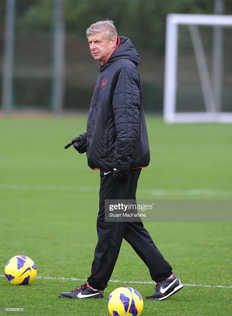 Arsenal manager <a gi-track='captionPersonalityLinkClicked' href=/galleries/search?phrase=Arsene+Wenger&family=editorial&specificpeople=171184 ng-click='$event.stopPropagation()'>Arsene Wenger</a> during a training session at London Colney on November 27, 2012 in St Albans, England.