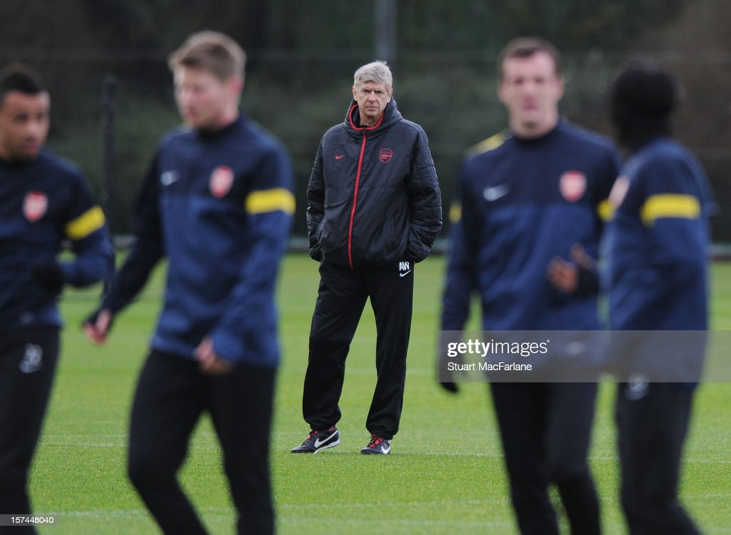 Arsenal manager <a gi-track='captionPersonalityLinkClicked' href=/galleries/search?phrase=Arsene+Wenger&family=editorial&specificpeople=171184 ng-click='$event.stopPropagation()'>Arsene Wenger</a> during a training session at London Colney on December 03, 2012 in St Albans, England.