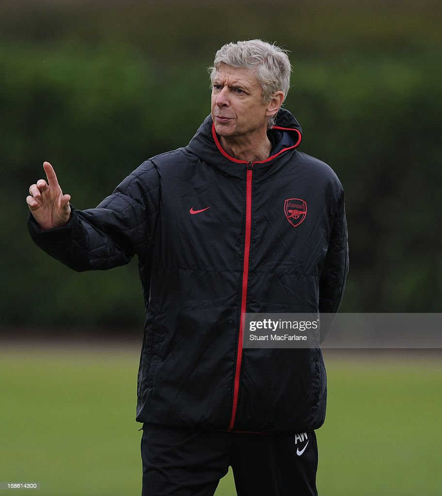 Arsenal manager <a gi-track='captionPersonalityLinkClicked' href=/galleries/search?phrase=Arsene+Wenger&family=editorial&specificpeople=171184 ng-click='$event.stopPropagation()'>Arsene Wenger</a> during a training session at London Colney on December 21, 2012 in St Albans, England.