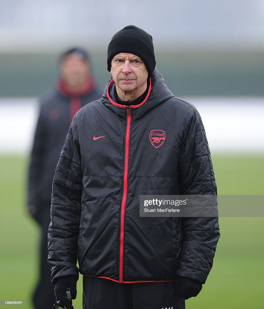 Arsenal manager <a gi-track='captionPersonalityLinkClicked' href=/galleries/search?phrase=Arsene+Wenger&family=editorial&specificpeople=171184 ng-click='$event.stopPropagation()'>Arsene Wenger</a> during a training session at London Colney on January 15, 2013 in St Albans, England.