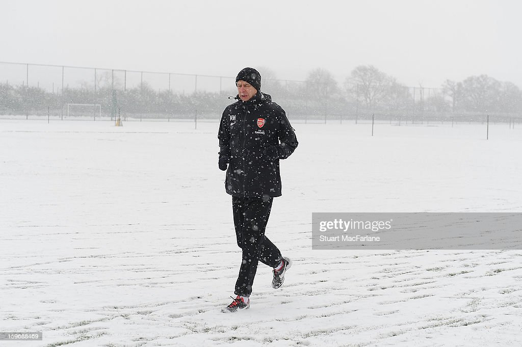 Arsenal manager <a gi-track='captionPersonalityLinkClicked' href=/galleries/search?phrase=Arsene+Wenger&family=editorial&specificpeople=171184 ng-click='$event.stopPropagation()'>Arsene Wenger</a> during a training session at London Colney on January 18, 2013 in St Albans, England.