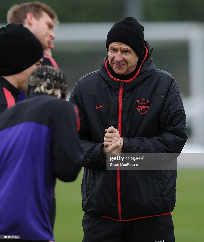 Arsenal manager <a gi-track='captionPersonalityLinkClicked' href=/galleries/search?phrase=Arsene+Wenger&family=editorial&specificpeople=171184 ng-click='$event.stopPropagation()'>Arsene Wenger</a> during a training session at London Colney on January 25, 2013 in St Albans, England.