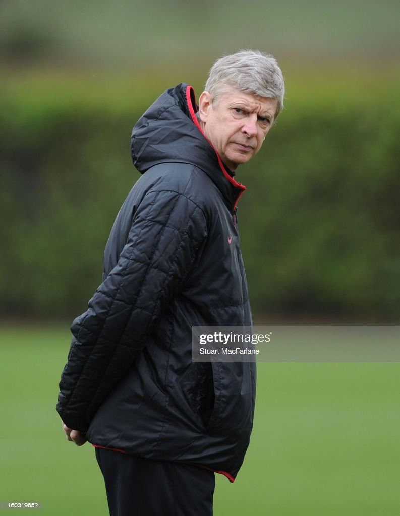 Arsenal manager <a gi-track='captionPersonalityLinkClicked' href=/galleries/search?phrase=Arsene+Wenger&family=editorial&specificpeople=171184 ng-click='$event.stopPropagation()'>Arsene Wenger</a> during a training session at London Colney on January 29, 2013 in St Albans, England.