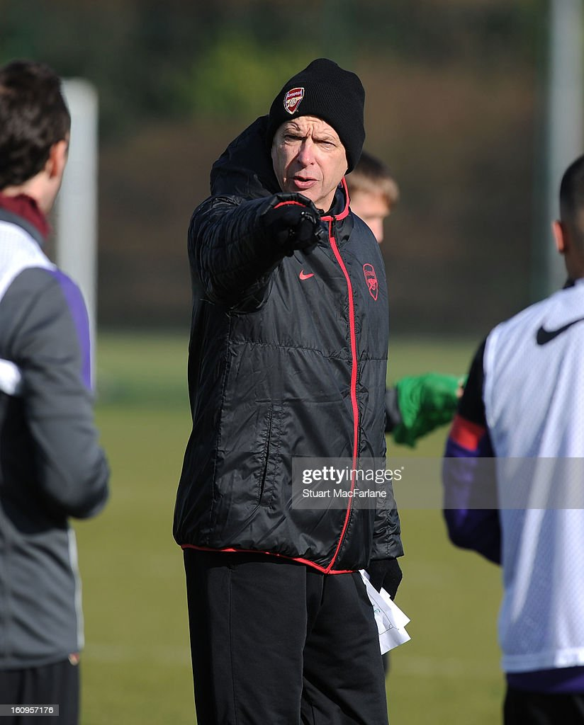 Arsenal manager Arsene Wenger during a training session at London Colney on February 08, 2013 in St Albans, England.