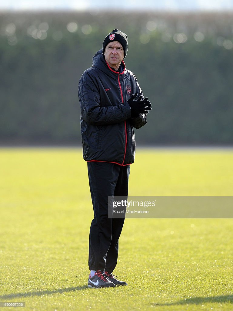 Arsenal manager <a gi-track='captionPersonalityLinkClicked' href=/galleries/search?phrase=Arsene+Wenger&family=editorial&specificpeople=171184 ng-click='$event.stopPropagation()'>Arsene Wenger</a> during a training session at London Colney on February 08, 2013 in St Albans, England.