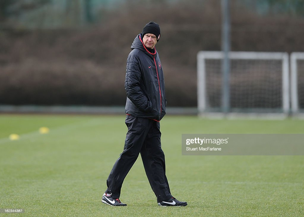 Arsenal manager <a gi-track='captionPersonalityLinkClicked' href=/galleries/search?phrase=Arsene+Wenger&family=editorial&specificpeople=171184 ng-click='$event.stopPropagation()'>Arsene Wenger</a> during a training session at London Colney on February 22, 2013 in St Albans, England.