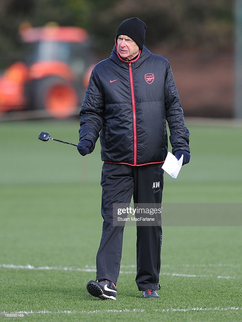 Arsenal manager <a gi-track='captionPersonalityLinkClicked' href=/galleries/search?phrase=Arsene+Wenger&family=editorial&specificpeople=171184 ng-click='$event.stopPropagation()'>Arsene Wenger</a> during a training session at London Colney on March 12, 2013 in St Albans, England.