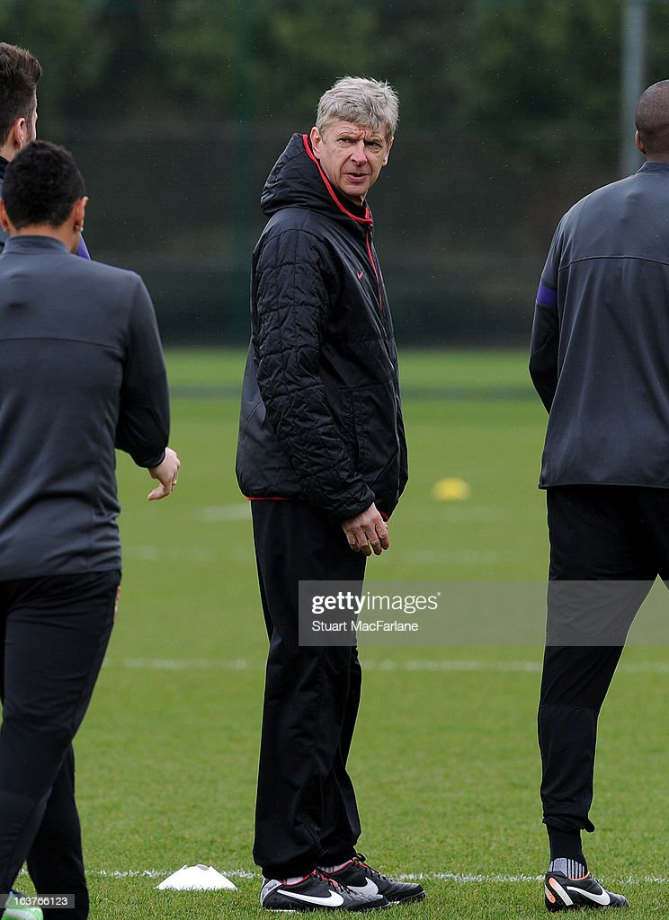 Arsenal manager <a gi-track='captionPersonalityLinkClicked' href=/galleries/search?phrase=Arsene+Wenger&family=editorial&specificpeople=171184 ng-click='$event.stopPropagation()'>Arsene Wenger</a> during a training session at London Colney on March 15, 2013 in St Albans, England.