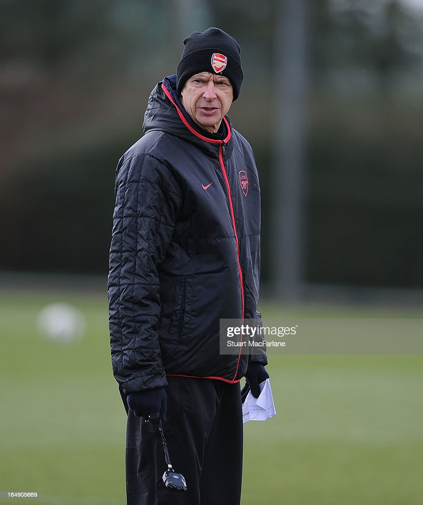 Arsenal manager <a gi-track='captionPersonalityLinkClicked' href=/galleries/search?phrase=Arsene+Wenger&family=editorial&specificpeople=171184 ng-click='$event.stopPropagation()'>Arsene Wenger</a> during a training session at London Colney on March 29, 2013 in St Albans, England.