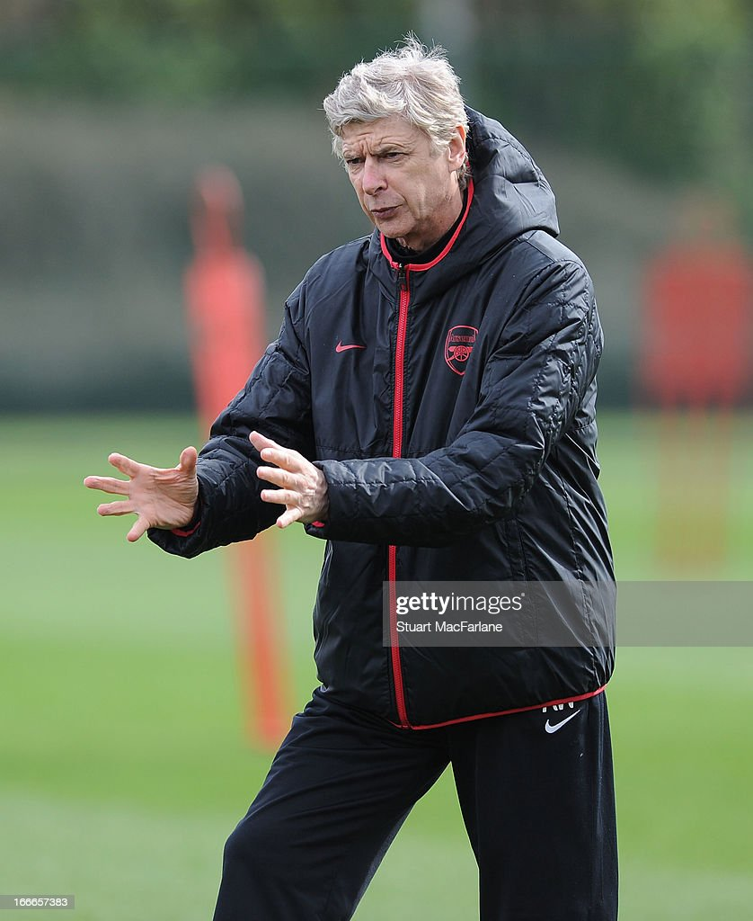 Arsenal manager <a gi-track='captionPersonalityLinkClicked' href=/galleries/search?phrase=Arsene+Wenger&family=editorial&specificpeople=171184 ng-click='$event.stopPropagation()'>Arsene Wenger</a> during a training session at London Colney on April 15, 2013 in St Albans, England.