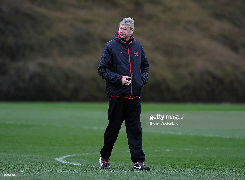 Arsenal manager <a gi-track='captionPersonalityLinkClicked' href=/galleries/search?phrase=Arsene+Wenger&family=editorial&specificpeople=171184 ng-click='$event.stopPropagation()'>Arsene Wenger</a> during a training session at London Colney on April 19, 2013 in St Albans, England.