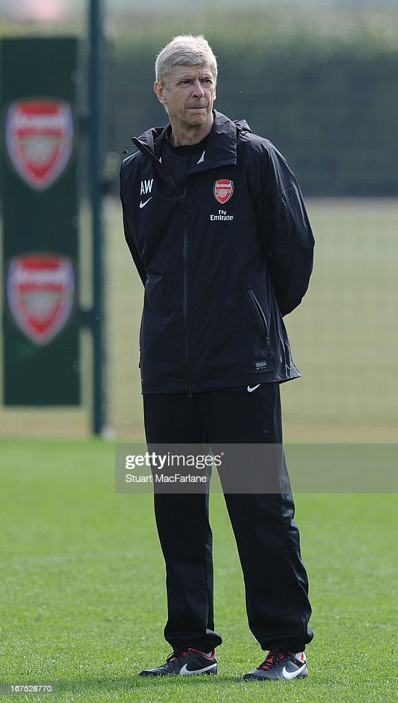Arsenal manager <a gi-track='captionPersonalityLinkClicked' href=/galleries/search?phrase=Arsene+Wenger&family=editorial&specificpeople=171184 ng-click='$event.stopPropagation()'>Arsene Wenger</a> during a training session at London Colney on April 26, 2013 in St Albans, England.