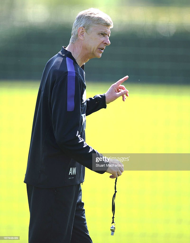Arsenal manager <a gi-track='captionPersonalityLinkClicked' href=/galleries/search?phrase=Arsene+Wenger&family=editorial&specificpeople=171184 ng-click='$event.stopPropagation()'>Arsene Wenger</a> during a training session at London Colney on May 03, 2013 in St Albans, England.