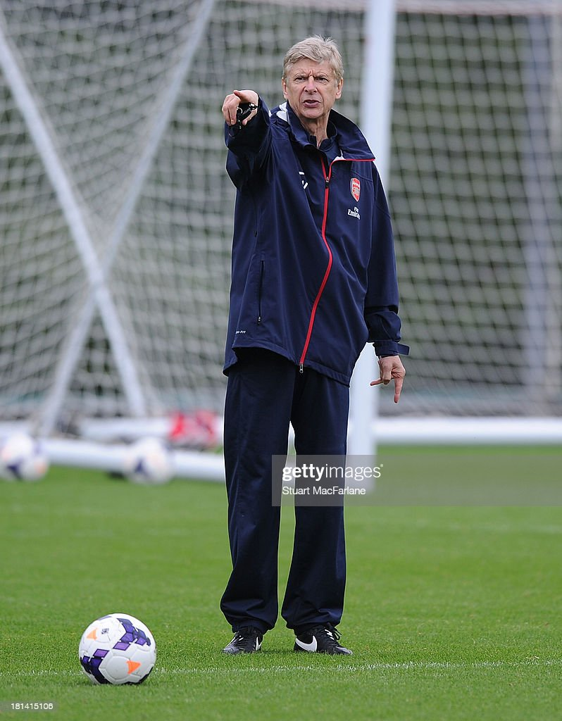 Arsenal manager <a gi-track='captionPersonalityLinkClicked' href=/galleries/search?phrase=Arsene+Wenger&family=editorial&specificpeople=171184 ng-click='$event.stopPropagation()'>Arsene Wenger</a> during a training session at London Colney on September 21, 2013 in St Albans, England.