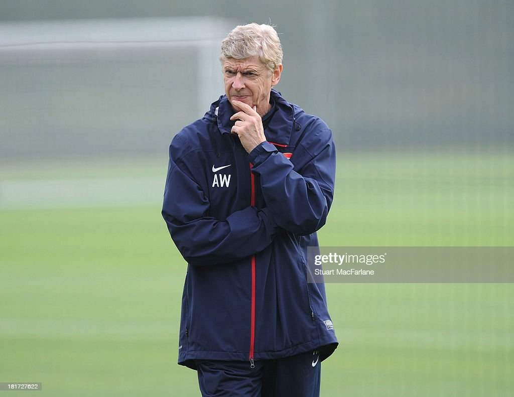 Arsenal manager Arsene Wenger during a training session at London Colney on September 24, 2013 in St Albans, England.