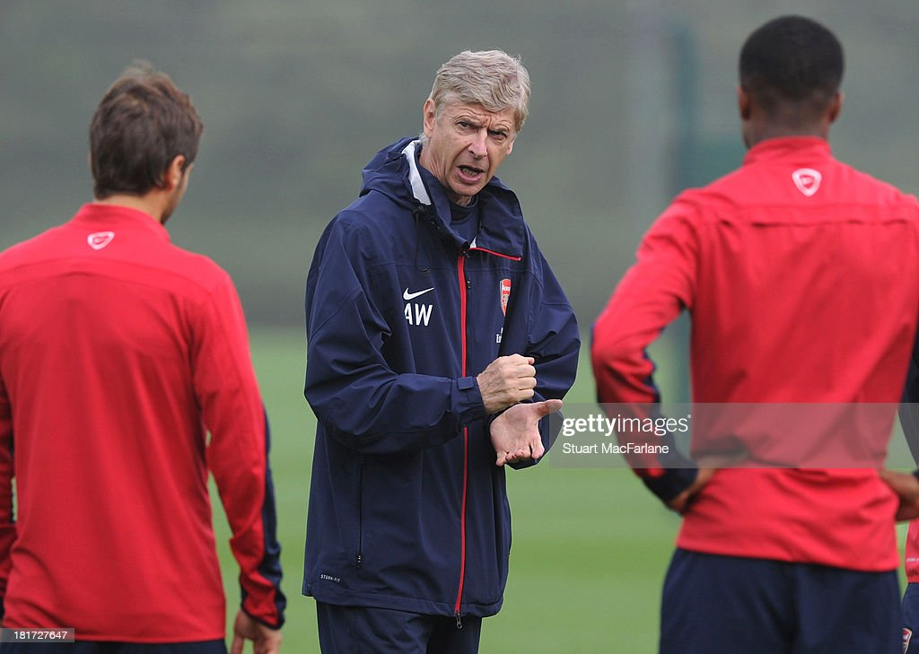 Arsenal manager <a gi-track='captionPersonalityLinkClicked' href=/galleries/search?phrase=Arsene+Wenger&family=editorial&specificpeople=171184 ng-click='$event.stopPropagation()'>Arsene Wenger</a> during a training session at London Colney on September 24, 2013 in St Albans, England.