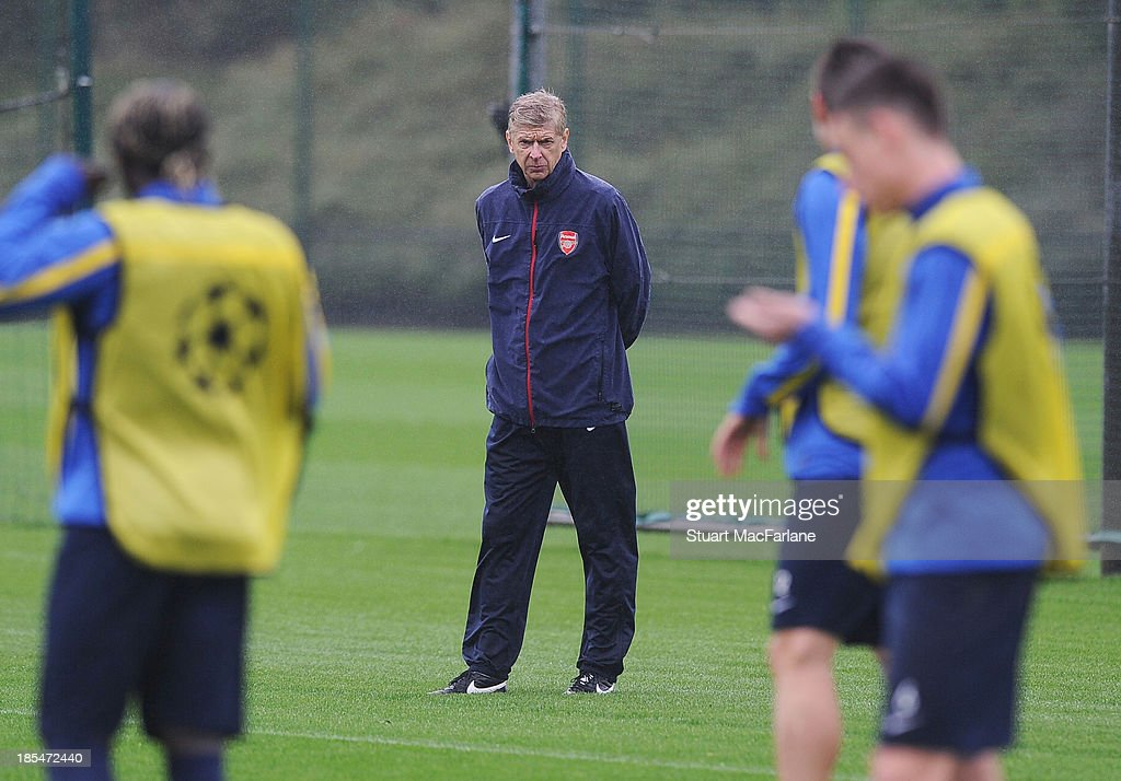 Arsenal manager <a gi-track='captionPersonalityLinkClicked' href=/galleries/search?phrase=Arsene+Wenger&family=editorial&specificpeople=171184 ng-click='$event.stopPropagation()'>Arsene Wenger</a> during a training session at London Colney on October 21, 2013 in St Albans, England.