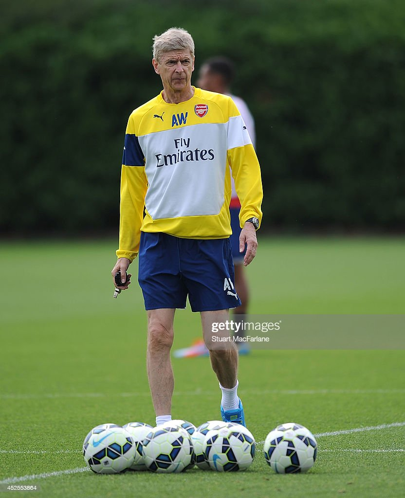Arsenal manager Arsene Wenger during a training session at London Colney on July 23, 2014 in St Albans, England.