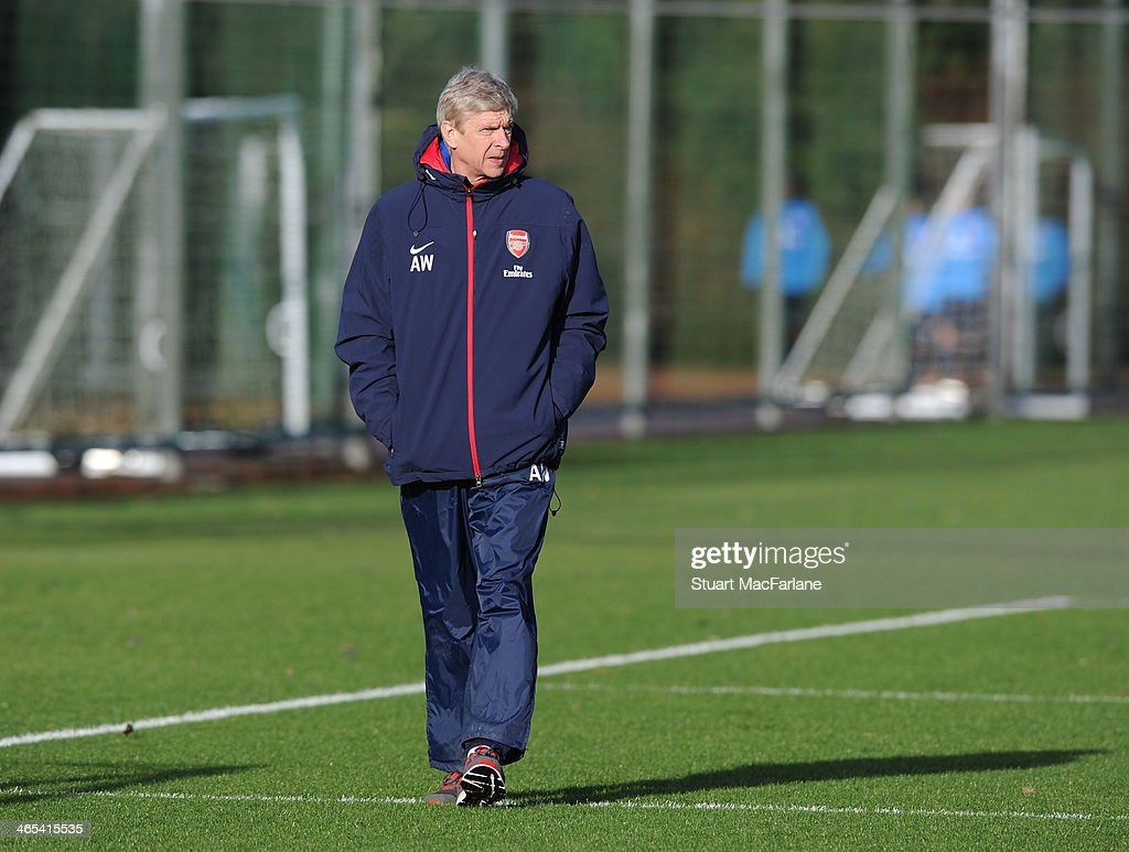 Arsenal manager Arsene Wenger during a training session at London Colney on January 27, 2014 in St Albans, England.