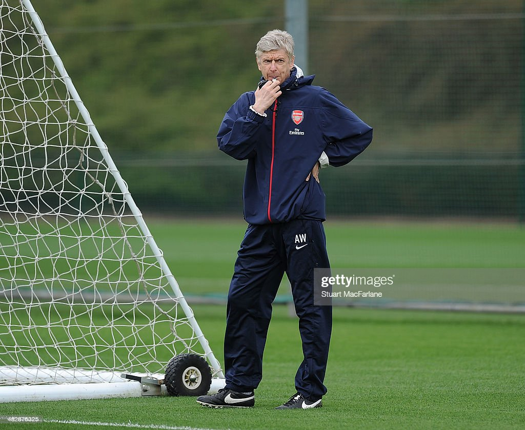 Arsenal manager Arsene Wenger during a training session at London Colney on April 5, 2014 in St Albans, England.