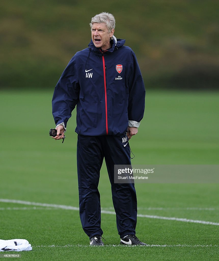Arsenal manager <a gi-track='captionPersonalityLinkClicked' href=/galleries/search?phrase=Arsene+Wenger&family=editorial&specificpeople=171184 ng-click='$event.stopPropagation()'>Arsene Wenger</a> during a training session at London Colney on April 5, 2014 in St Albans, England.