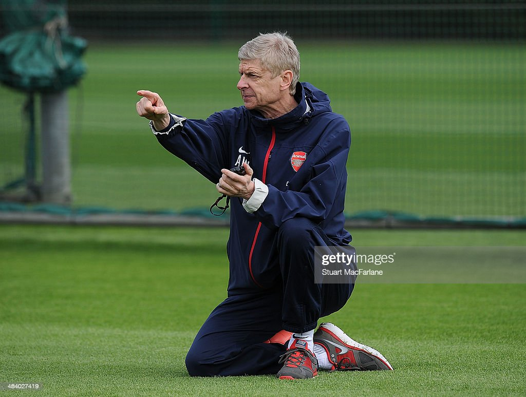 Arsenal manager Arsene Wenger during a training session at London Colney on April 11, 2014 in St Albans, England.