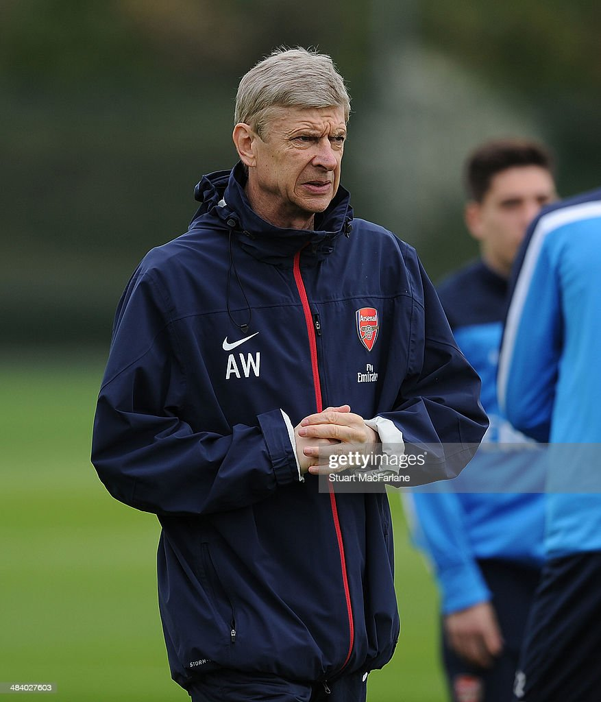 ST. ALBANS, ENGLAND - Arsenal manager <a gi-track='captionPersonalityLinkClicked' href=/galleries/search?phrase=Arsene+Wenger&family=editorial&specificpeople=171184 ng-click='$event.stopPropagation()'>Arsene Wenger</a> during a training session at London Colney on April 11, 2014 in St Albans, England.
