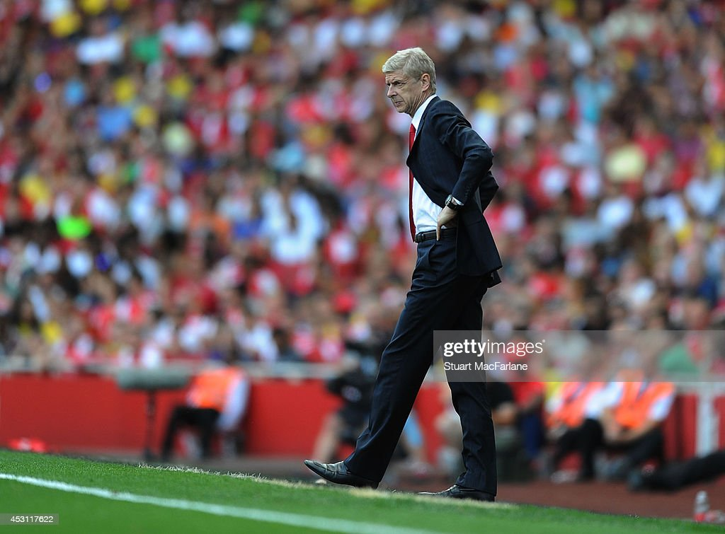 Arsenal manager Arsene Wenger during the Emirates Cup match between Arsenal and AS Monaco at Emirates Stadium on August 3, 2014 in London, England.