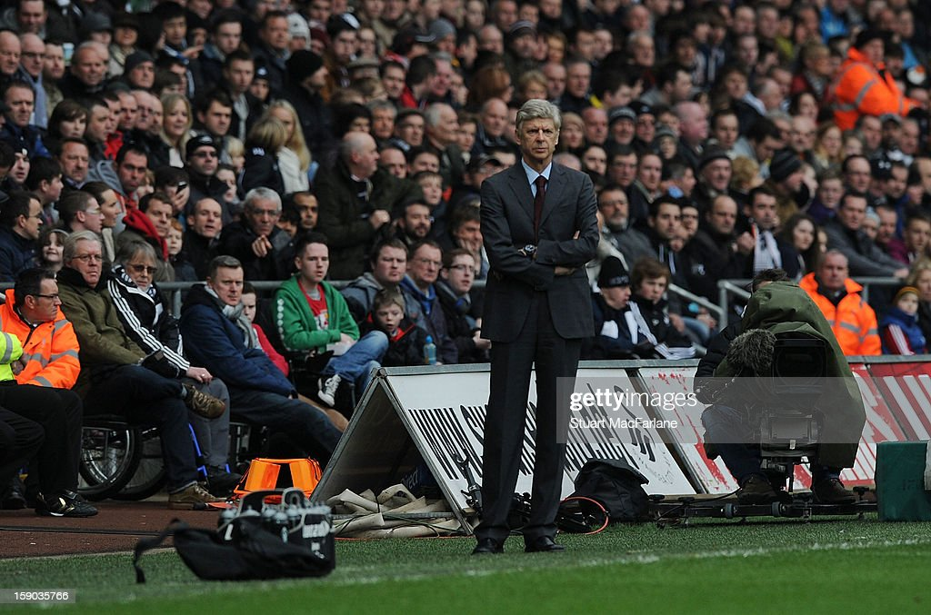Arsenal manager Arsene Wenger during the FA Cup Third Round match between Swansea City and Arsenal at the Liberty Stadium on January 6, 2013 in Swansea, Wales.