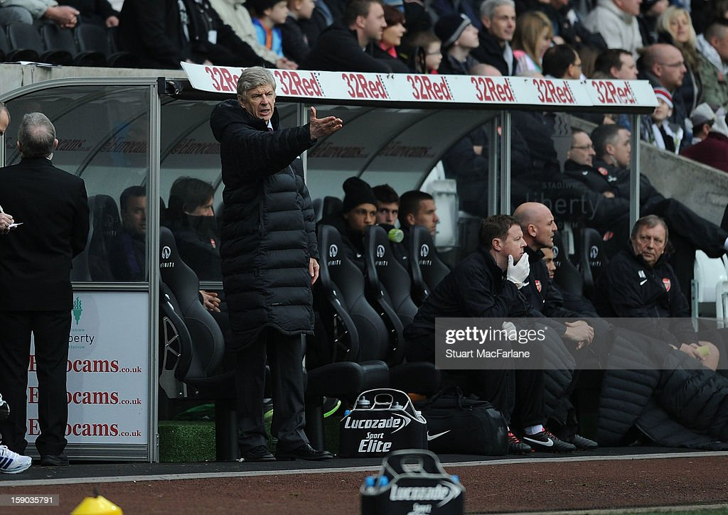 Arsenal manager <a gi-track='captionPersonalityLinkClicked' href=/galleries/search?phrase=Arsene+Wenger&family=editorial&specificpeople=171184 ng-click='$event.stopPropagation()'>Arsene Wenger</a> during the FA Cup Third Round match between Swansea City and Arsenal at the Liberty Stadium on January 6, 2013 in Swansea, Wales.