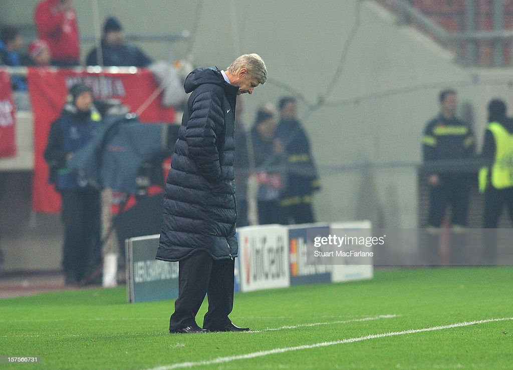 Arsenal manager <a gi-track='captionPersonalityLinkClicked' href=/galleries/search?phrase=Arsene+Wenger&family=editorial&specificpeople=171184 ng-click='$event.stopPropagation()'>Arsene Wenger</a> during the UEFA Champions League Group B match between Olympiacos FC and Arsenal FC at Georgios Karaiskakis Stadium on December 04, 2012 in Athens, Greece.