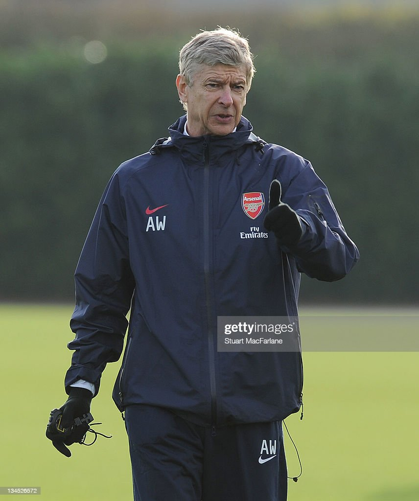 Arsenal manager <a gi-track='captionPersonalityLinkClicked' href=/galleries/search?phrase=Arsene+Wenger&family=editorial&specificpeople=171184 ng-click='$event.stopPropagation()'>Arsene Wenger</a> gestures during a training session at London Colney on December 2, 2011 in St Albans, England.