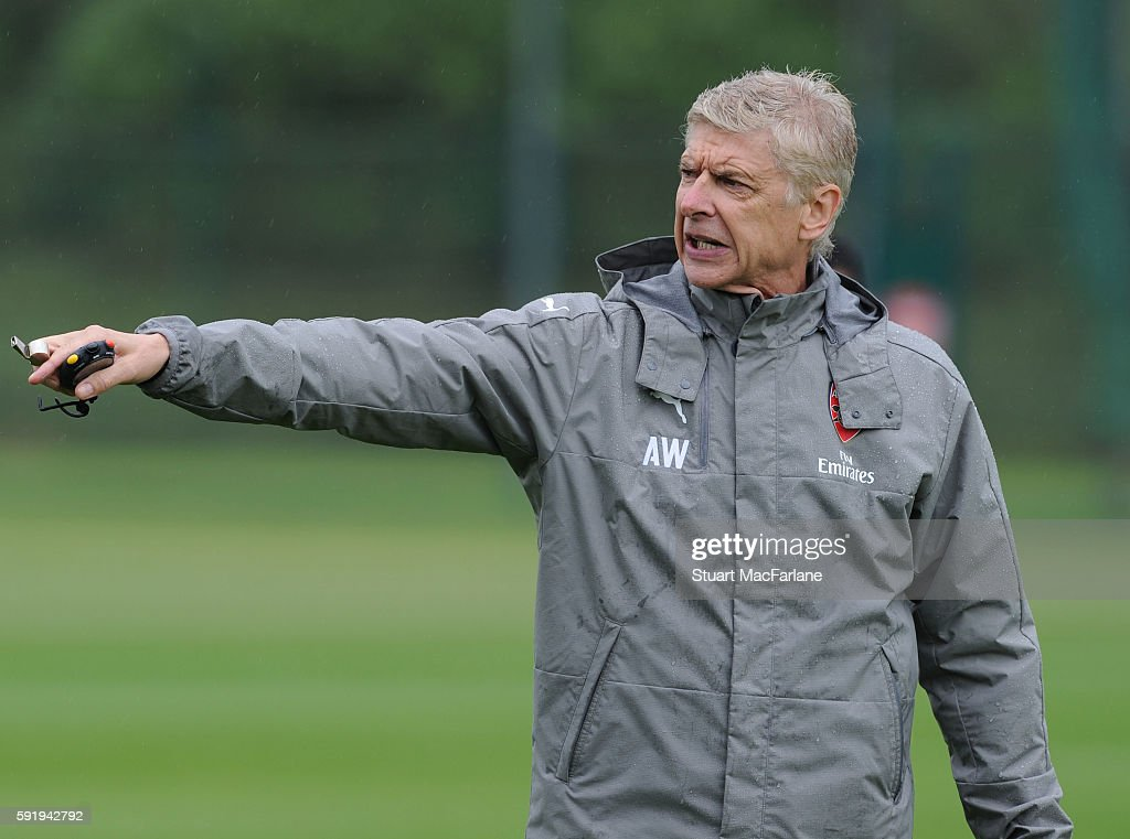 Arsenal manager Arsene Wenger gestures during a training session at London Colney on August 19 2016 in St Albans England