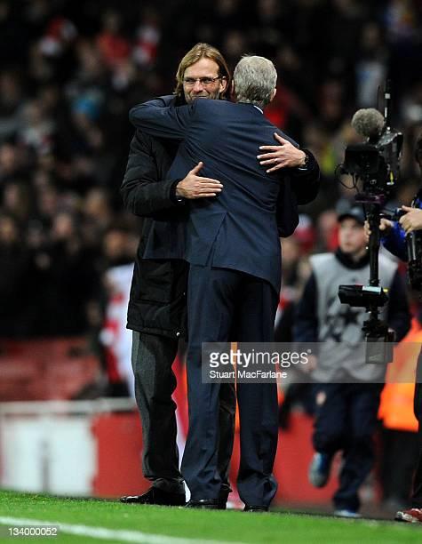 Arsenal manager Arsene Wenger hugs Dortmund coach Jurgen Klopp after the UEFA Champions League Group F match between Arsenal FC and Borussia Dortmund...