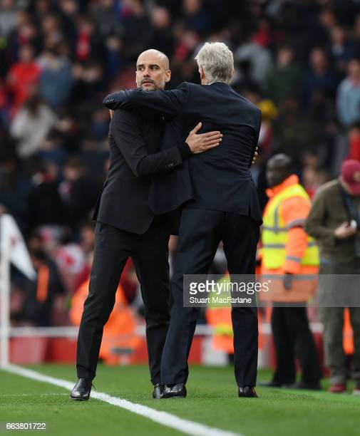Arsenal manager Arsene Wenger hugs Man City manager Pep Guardiola after the Premier League match between Arsenal and Manchester City at Emirates...