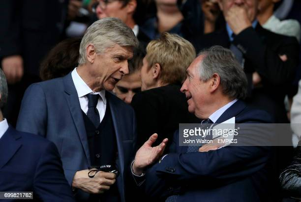 Arsenal manager Arsene Wenger in the stands before the game with Gerard Houllier