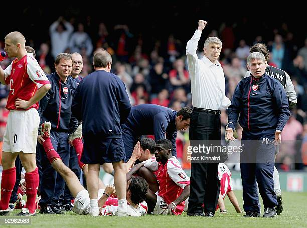 Arsenal Manager Arsene Wenger in the white shirt salutes the fans after winning the FA Cup Final between Arsenal and Manchester United 54 on...