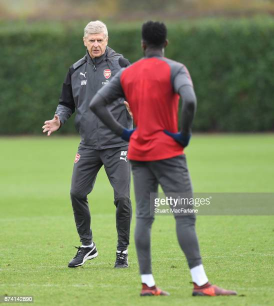 Arsenal manager Arsene Wenger instructs Dnny Welbeck during a training session at London Colney on November 14 2017 in St Albans England