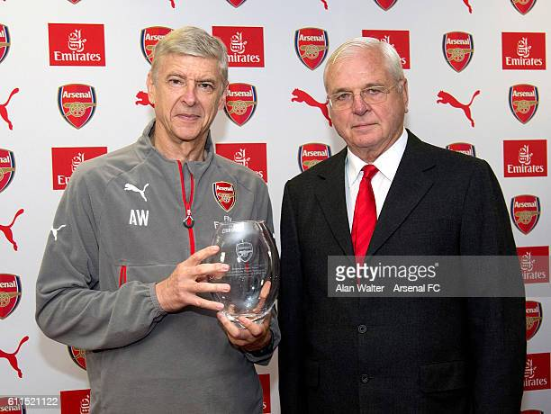 Arsenal manager Arsene Wenger is presented a gift by Chairman Sir Chips Keswick to mark his twenty years at the club at a press conference at London...