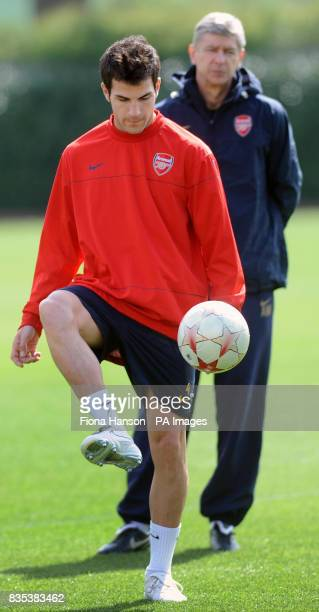 Arsenal manager Arsene Wenger keeps an eye on Francesc Fabregas during a training session at London Colney Training Ground London