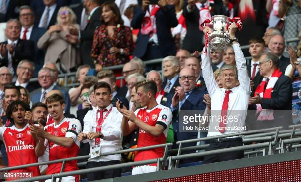 Arsenal manager Arsene Wenger lifts the trophy during the Emirates FA Cup Final match between Arsenal and Chelsea at Wembley Stadium on May 27 2017...