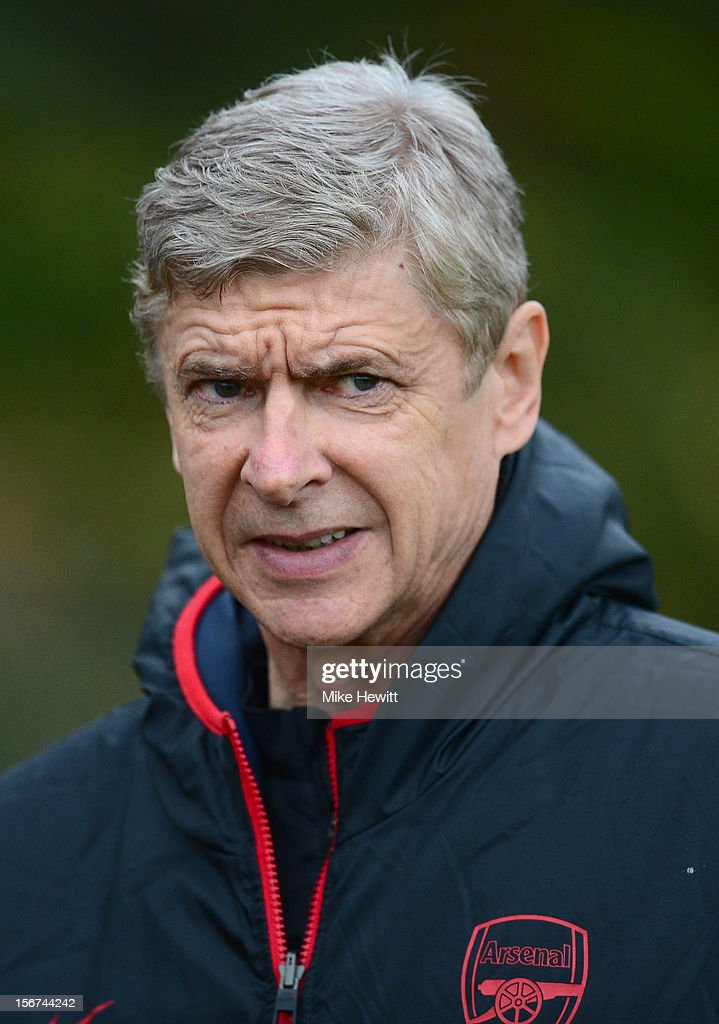 Arsenal manager Arsene Wenger look on during a training session at London Colney ahead of tomorrow's UEFA Champions League Group B match against Montpellier on November 20, 2012 in St Albans, England.