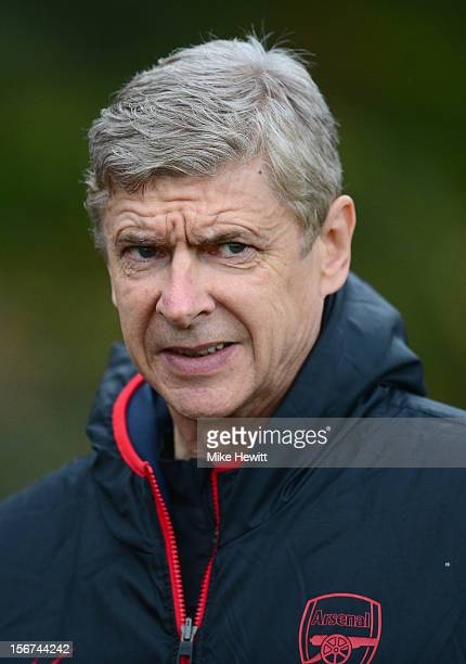 Arsenal manager Arsene Wenger look on during a training session at London Colney ahead of tomorrow's UEFA Champions League Group B match against...