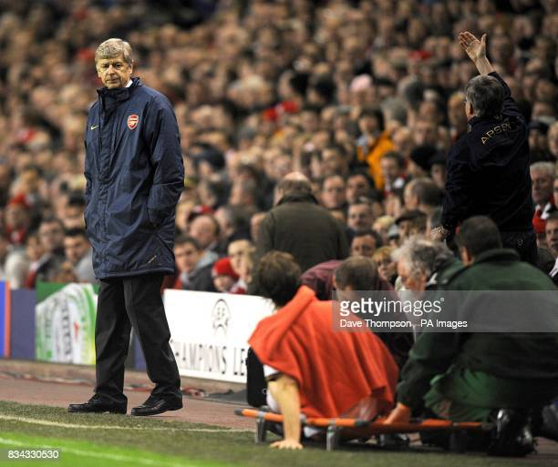 Arsenal manager Arsene Wenger looks at Mathieu Flamini as he is stretchered off with an injury