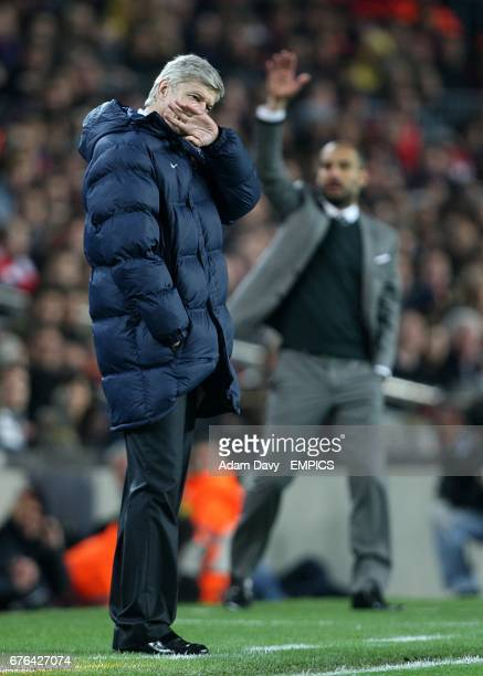 Arsenal manager Arsene Wenger looks dejected as Barcelona manager Josep Guardiola directs his players from the touchline