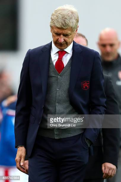 Arsenal manager Arsene Wenger looks dejected following the Premier League match between Stoke City and Arsenal at Bet365 Stadium on August 19 2017 in...